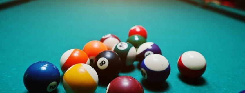 bigstock Billiard Balls In A Pool Table 132799604